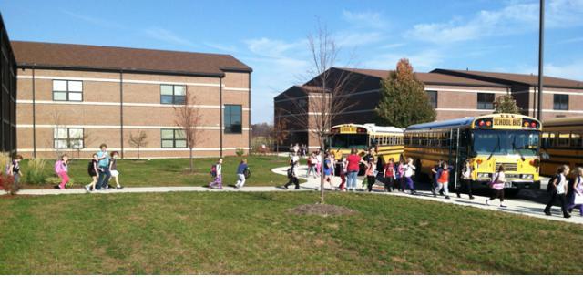 Children running to school buses